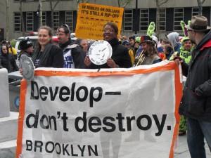 City Councilwoman Letitia James, with oversized coin, led Develop Don't Destroy Brooklyn's walk-a-thon Saturday from Borough Hall to Habana Outpost to protest Atlantic Yards.
