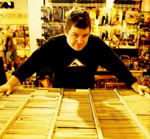 Oswalt in a comic book store.  (Photo: Gareth-Michael Skarka, The Designer Monologues)